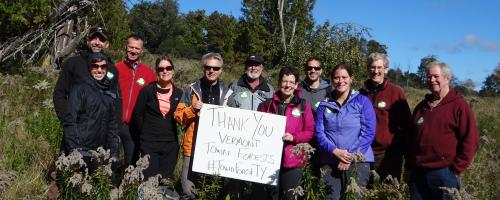Group with sign: Thank you Vermont town forests