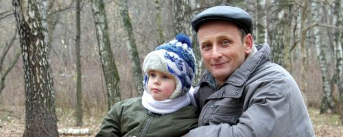 man and kid in woods
